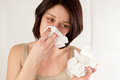 Woman sneezing holding tissues allergy or cold flu concept Stock Photo