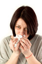 Woman sneezing holding tissues allergy or cold flu concept Stock Images