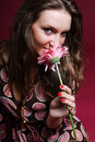 Woman sniffing a flower Royalty Free Stock Image