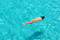 Woman snorkeling in crystal clear turquoise water at tropical beach Stock Photography