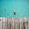 Woman snorkeling in crystal clear turquoise water at tropical beach Royalty Free Stock Photography