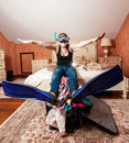 Woman in snorkeling equipment sitting on bed funny portrait of Royalty Free Stock Image