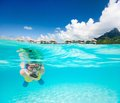 Woman snorkeling in a tropical lagoon Stock Image