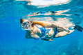 Woman Snorkeling in Tropical Ocean Royalty Free Stock Photography