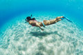 Woman snorkeling in tropical sea underwater image of a over sandy bottom Stock Photography