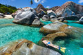 Woman snorkeling at tropical water young in turquoise among huge granite boulders the baths beach area major tourist attraction on Royalty Free Stock Images
