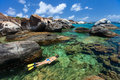 Woman snorkeling at tropical water young in turquoise among huge granite boulders the baths beach area major tourist attraction on Stock Photography