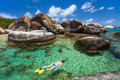 Woman snorkeling at tropical water young in turquoise among huge granite boulders the baths beach area major tourist attraction on Stock Image