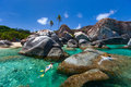 Woman snorkeling at tropical water young in turquoise among huge granite boulders the baths beach area major tourist attraction on Stock Photos