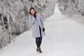 Woman on snow covered road Royalty Free Stock Photo