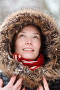 Woman in snow forest with neckpiece and red scarf smiling Stock Photos