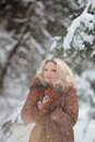 Woman in snow winter forest Stock Photos
