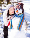 Woman with a snowman Royalty Free Stock Images