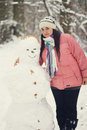 Woman and a snowman Royalty Free Stock Photo