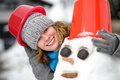 Woman and a snowman Stock Photography
