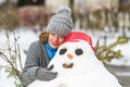 Woman and a snowman Royalty Free Stock Photography