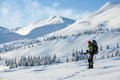 Woman snowshoeing in winter carpathian mountains Stock Photography