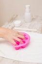 Woman soaking her nails in nail bowls at the beauty salon Stock Images
