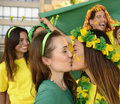 Woman soccer fans kissing multi ethnic women each other celebrating Stock Photography