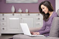 Woman on the sofa using laptop Royalty Free Stock Photo