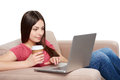Woman on sofa using laptop Royalty Free Stock Photo