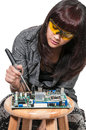 Woman soldering beautiful repair a printed circuit board Royalty Free Stock Image