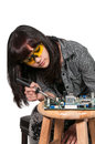 Woman soldering beautiful repair a printed circuit board Stock Photo