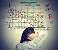 Woman solving bad economy problem. Stressful business life Royalty Free Stock Photo