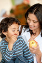 Woman and son eating fruits Stock Images