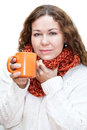 Woman with a sore throat drinking hot tea from a cup isolated on white background Stock Photos