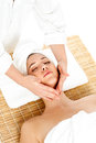 Woman in spa gets a facial massage young attractive getting treatment Royalty Free Stock Images