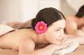 Woman in spa with hot stones picture of salon Stock Photography
