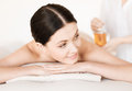 Woman in spa picture of salon getting oil treatment Stock Photography