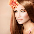 Woman at spa portrait of attractive female with orange flower in head isolated on pastel background gentle makeup day luxury Royalty Free Stock Image