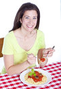 Woman with spaghetti Stock Photo