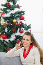 Woman speaking mobile phone near Chris(tmas tree Royalty Free Stock Photos