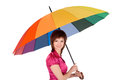 Woman with spectrum umbrella over white Stock Photos