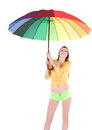 Woman with spectrum umbrella over white background Royalty Free Stock Photos