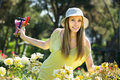 Woman spending free time in the garden happy a summer hat his Stock Photos