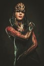 Woman with spider body art young and mask Stock Photos