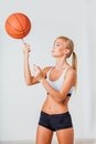 Woman spinning ball blonde on the finger Royalty Free Stock Photos