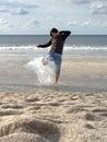 Woman splashing in sea Stock Photo