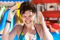 Woman splashing water in the ocean yong happy Royalty Free Stock Image