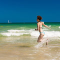 Woman splashing water in the ocean yong happy Stock Images