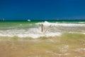 Woman splashing water in the ocean yong happy Stock Photo