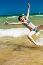 Woman splashing water in the ocean yong happy Royalty Free Stock Images