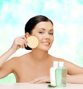 Woman with sponge health spa and beauty concept picture of and cosmetic bottles Royalty Free Stock Images