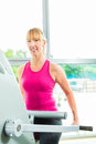 Woman in sport gym on stepper or fitness club exercising to gain more fitness Stock Photo