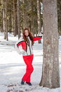 Woman in a sporting suit near a tree in-field Royalty Free Stock Photography