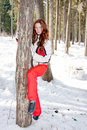 Woman in a sporting suit near a tree in-field Royalty Free Stock Images